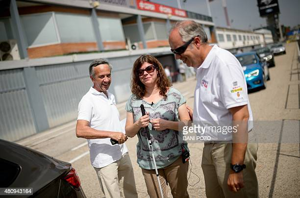 A blind woman walks to get into a car and drive during the Master Drive experience To drive an illusion at the Jarama Circuit in Madrid in July 16...