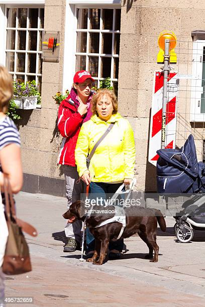 Blind woman with seeing-eye dog