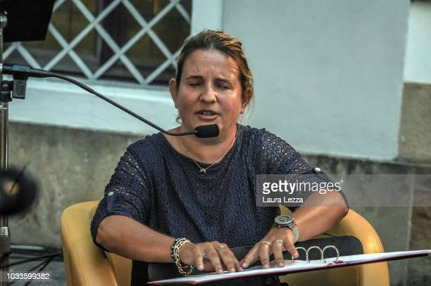 A blind young woman Antonella Iacoponi reading aloud with the Braille alphabet takes part in the collective 24 hour Marathon Reding of the I Promessi...