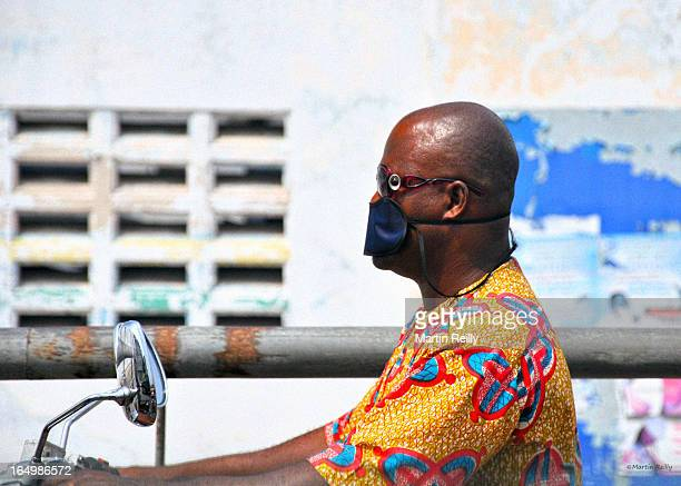 CONTENT] A blindfold on whilst riding a motor bike A motor cyclist rides through Cotonou in the Republic of Benin wearing both sunglasses and a sleep...
