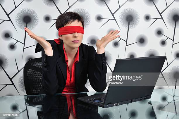 Blindfolded business woman