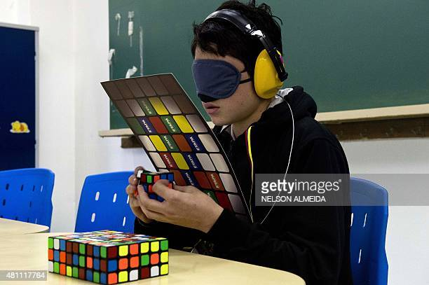 A blindfolded competitor tries to solve a Rubik's cube during the Rubik's Cube World Championship in Sao Paulo Brazil on July 17 2015 400 competitors...