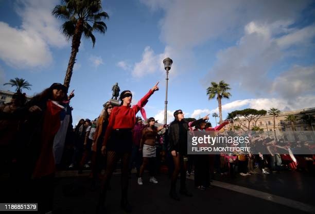 "Blindfolded feminist activists from the group ""Non Una di Meno !"" take part in a choreographed performance during a flashmob on December 7, 2019 on..."