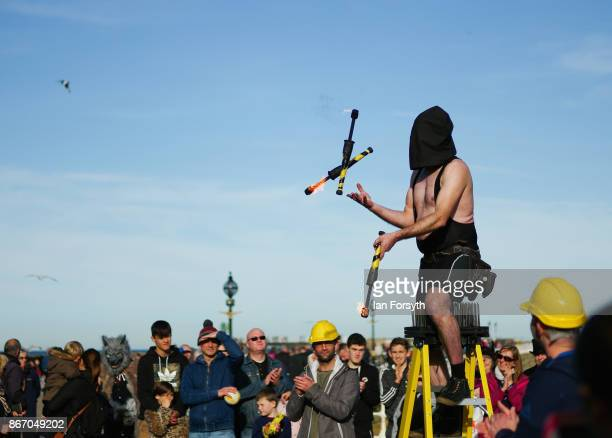 Blind-folded fire-juggler entertains goths and visitors during the Whitby Goth Weekend on October 27, 2017 in Whitby, England. The Whitby Goth...
