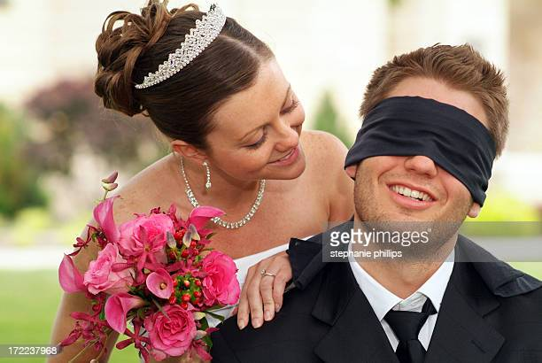 blindfolded groom will not see the bride before the wedding - blindfolded bride stock pictures, royalty-free photos & images