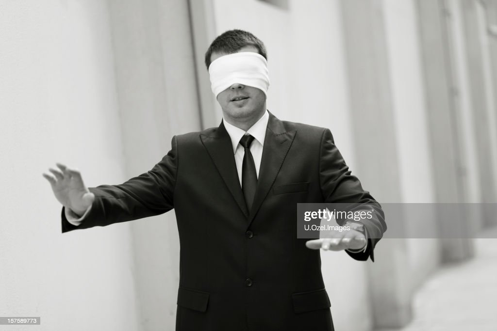 2d922c76f8a Blindfolded Lost Businessman Stock Photo - Getty Images