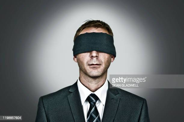 blindfolded man - forbidden stock pictures, royalty-free photos & images