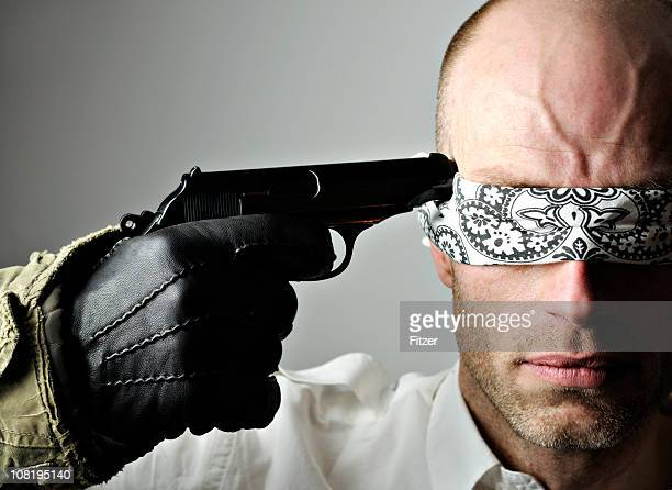 Blindfolded Man with Gun to Head