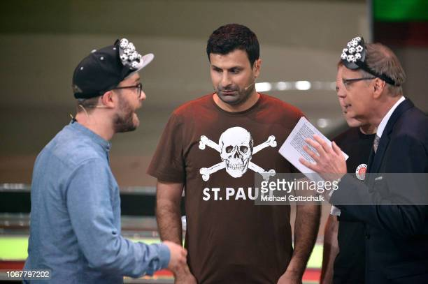 Blindfolded Mark Forster and Günther Jauch play football with Serdal Celebi on stage during the tv show '2018 Menschen Bilder Emotionen' on December...