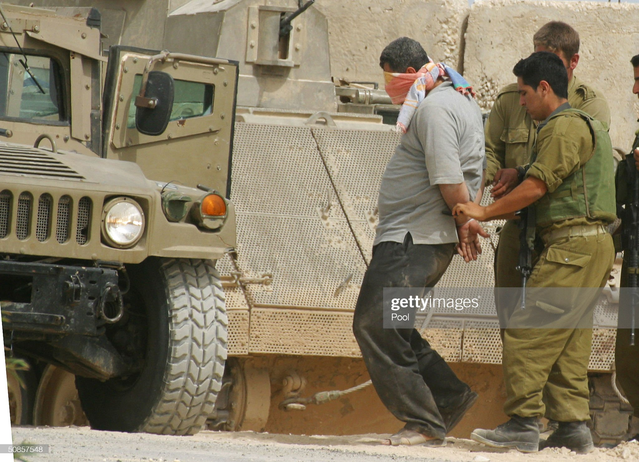 https://media.gettyimages.com/photos/blindfolded-palestinian-is-detained-and-moved-to-an-armored-car-the-picture-id50857548?s=2048x2048