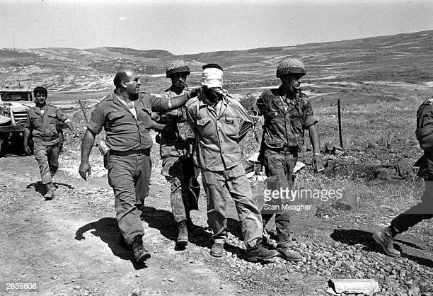 A blindfolded Russian prisoner in the hands of Israeli troops during Israel's advance into Syria in the Six Day War