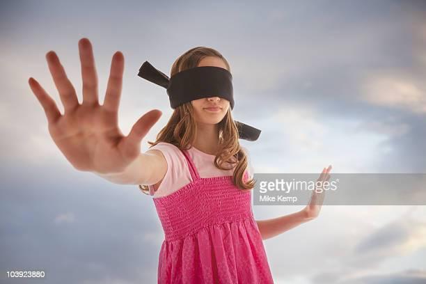 Blindfolded teenage girl
