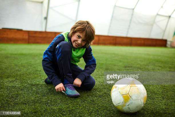 blindness & deafness - boy with cochlear implant - cochlear implant stock pictures, royalty-free photos & images