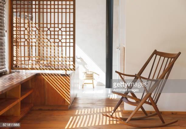 Blinds casting shadows in modern bedroom