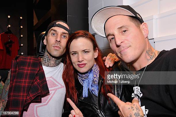 Blink 182 drummer Travis Barker actress Juliette Lewis and musician Toby Morse attend the launching of the One Life One Chance web store on December...