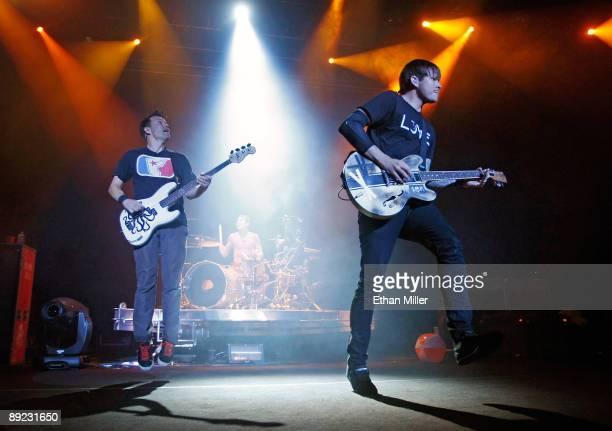 Blink-182 singer/bassist Mark Hoppus, drummer Travis Barker and singer/guitarist Tom DeLonge perform during the first show of the band's reunion tour...