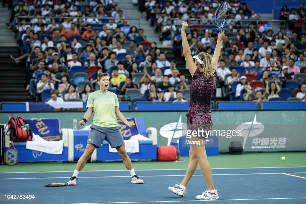 Blise Mertens of Belgium and Demi Schuurs of Netherland celebrate match point against Andrea Sestini Hlavackova and Barbora Strycova of Czech during...