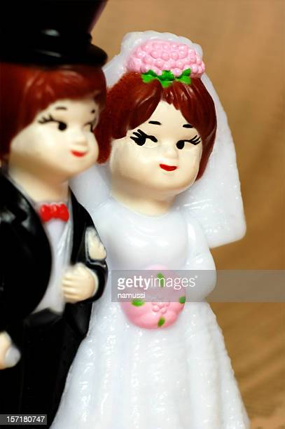 Blissful bride on big day: close up of cake topper