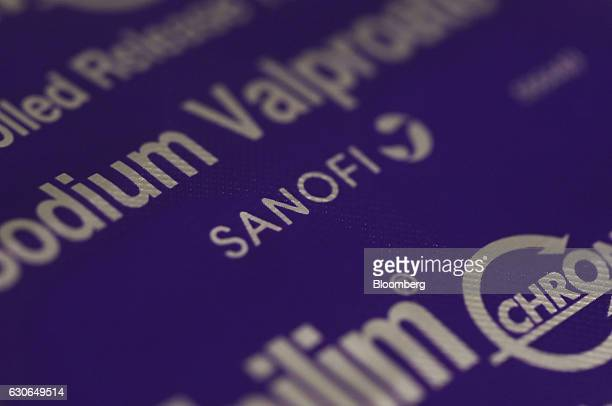A blister pack containing Epilim antiepilepsy tablets produced by Sanofi sits on a pharmacy counter in this arranged photograph in London UK on...