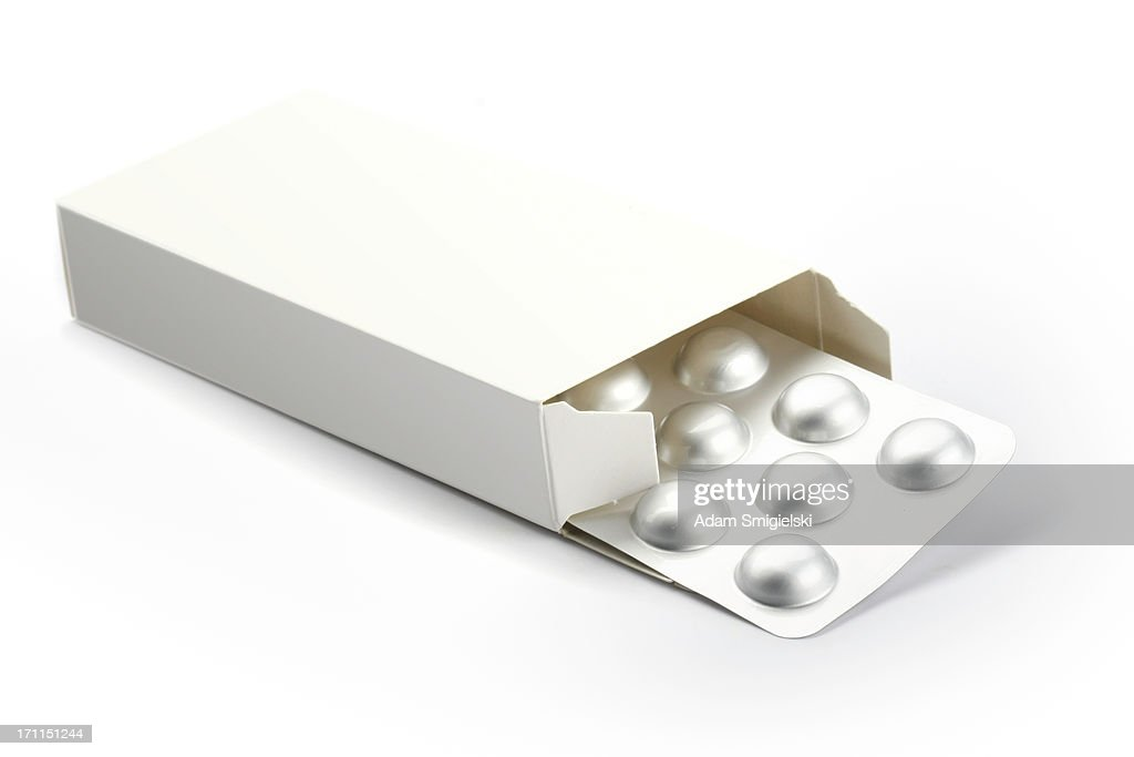 blisters with pills in a box isolated on white : Stock Photo
