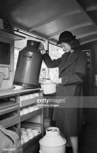 Women Of The Women's Voluntary Service Run A Mobile Canteen In London, England Patience 'Boo' Brand fills a large saucepan with water from the urn on...