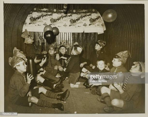 FUN Blitz or no blitz these boys of this Br Barnardo 's home were determined to spend their Christmas as usual and did so by making use of their...
