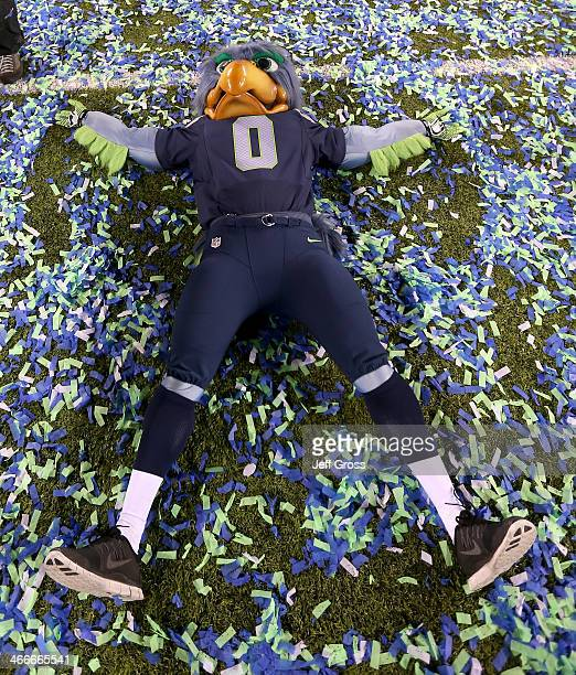 Blitz the Seattle Seahawks mascot does snow angels on the field after the Seahawks 438 victory against the Denver Broncos during Super Bowl XLVIII at...