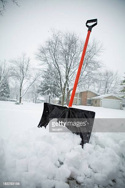 blizzard and snow shovel - snow shovel stock photos and pictures