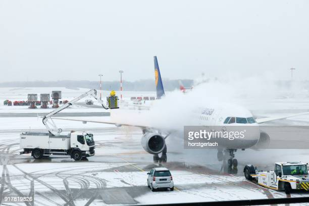 blizzard at hamburg international airport - brand name stock pictures, royalty-free photos & images