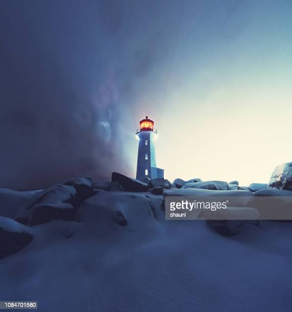 blizzard at peggy's cove lighthouse - freezing motion photos stock pictures, royalty-free photos & images