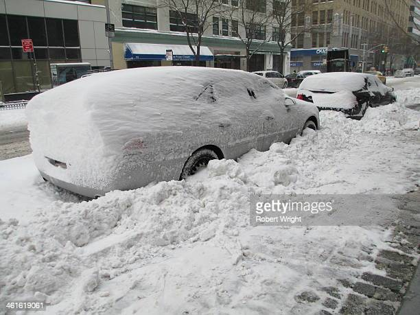 Blizzards during Winter Storm Hercules have blown snow into a distinctive shape on this car, parked on Hudson St, lower Manhattan, New York, on...