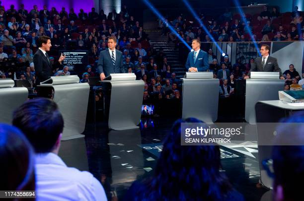 Bloc Quebecois leader YvesFrancois Blanchet People's Party of Canada leader Maxime Bernier and Conservative leader Andrew Scheer listen to Liberal...