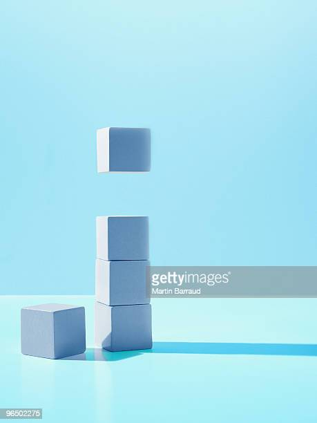 Block hovering over stack of blocks