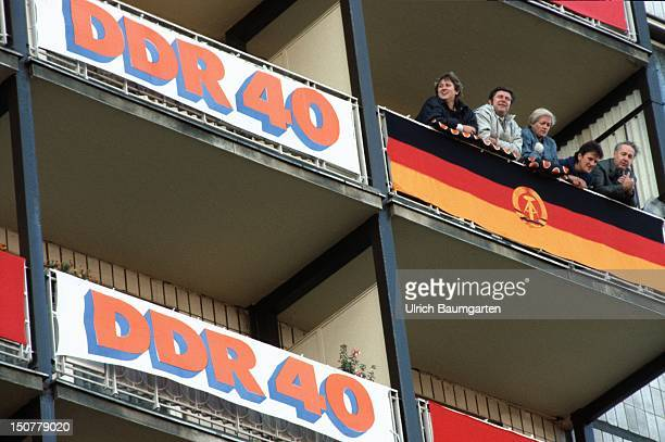 Block of flats with flags and banners for the 40 anniversary of the GDR