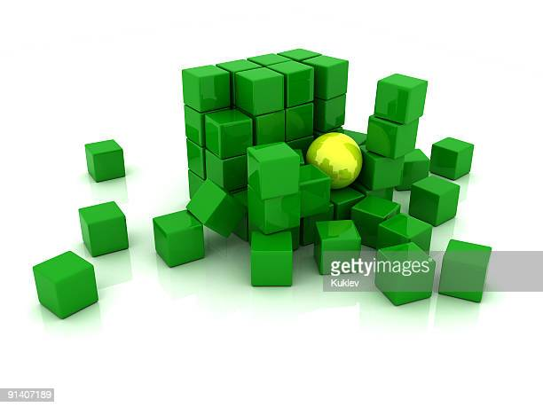 Block von grüne Würfel und große gelbe Kugel