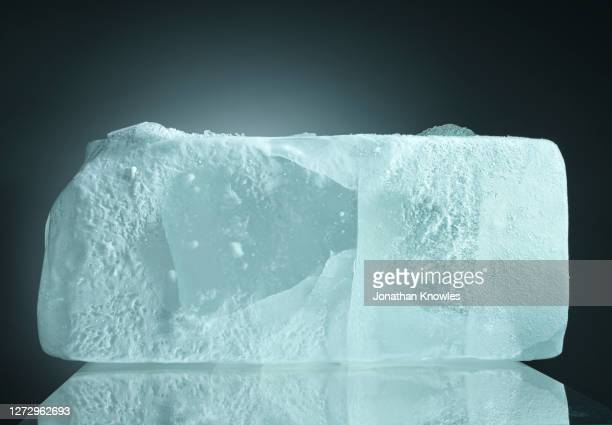 block of ice - iceberg ice formation stock pictures, royalty-free photos & images