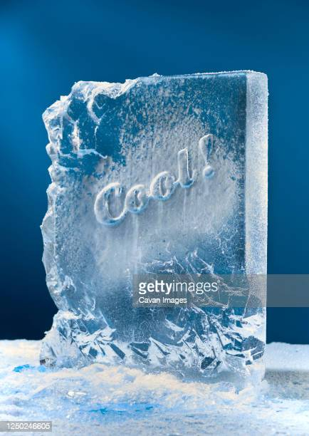 block of ice sculpture with cool carved in it. - frozen stock pictures, royalty-free photos & images