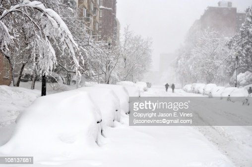 Block of snow-covered cars