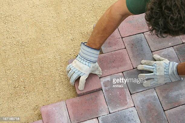 block paving being layed - landscaped stock pictures, royalty-free photos & images