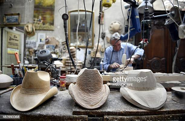 Block shaper Lorenzo Re works on a wooden hat block in his workshop La Forme in Paris on May 18 2015 Lorenzo Re is one of the last block shapers in...