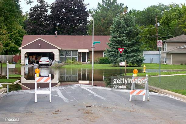 blocked flooded intersection - flood stock pictures, royalty-free photos & images