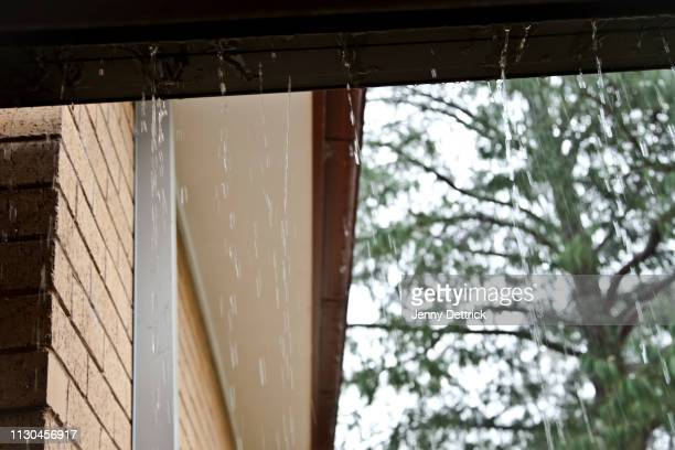 blocked gutters in a storm - heavy rain stockfoto's en -beelden