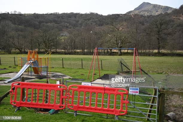 Blocked off playground is pictured at Capel Curig near Mount Snowdon in north Wales on April 5, 2020 as the warm weather tests the nationwide...