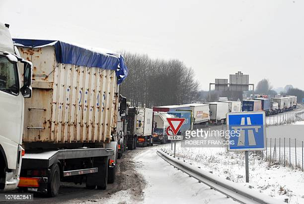 Blocked trucks queue to access the A28 highway on January 6 near NeufchâtelenBray western France as snow and ice in France caused traffic problems in...