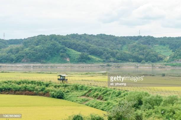 blockhause and fence at border between south and north korea - demilitarized zone stock pictures, royalty-free photos & images