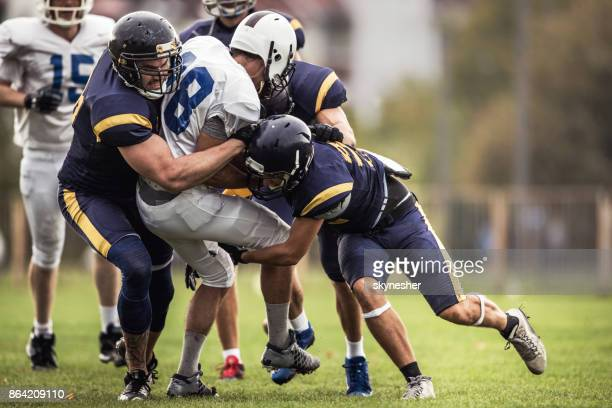 blocking an offensive player on american football match! - wide receiver athlete stock pictures, royalty-free photos & images