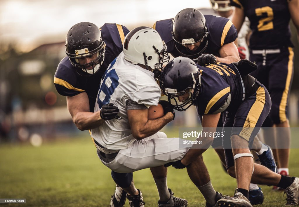 Blocking an offensive player! : Stock Photo