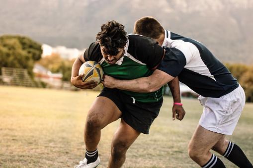 Blocking during rugby game 1058831162