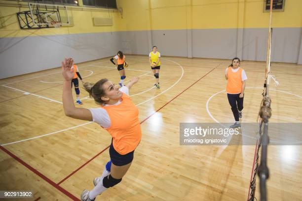 blocking the ball in volleyball - high school volleyball stock photos and pictures