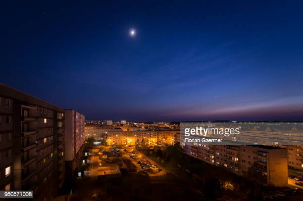 Blocks of flats are pictured at dusk on April 20 2018 in Stendal Germany